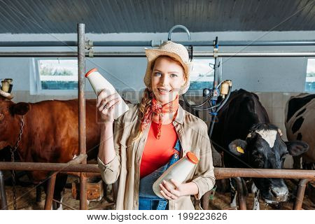 Farmer With Fresh Milk In Stall
