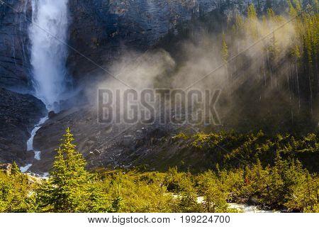 sun ray stakakkaw falls, yoho national park british columbia canada