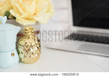 Feminine Workplace Concept. Freelance Workspace With Laptop, Flowers, Golden Pineapple. Blogger Work