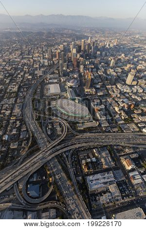 Los Angeles, California, USA - August 7, 2017:  Smoggy afternoon aerial view of downtown Los Angeles freeways in Southern California.