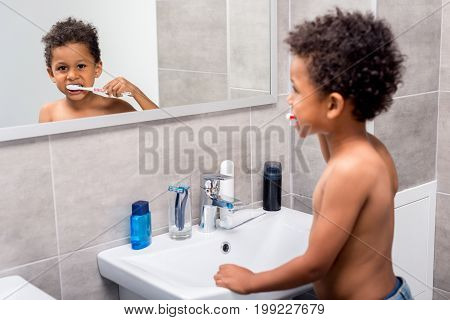 Afro Kid Brushing Teeth