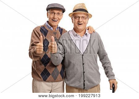 Seniors looking at the camera and holding their thumbs up isolated on white background