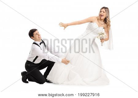 Groom trying to stop his bide from running away isolated on white background