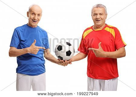 Two elderly soccer players holding a football and pointing isolated on white background