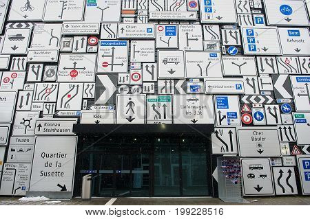 LUCERNE, SWITZERLAND - FEBRUARY 19, 2012: Display of the traffic signs at the exterior wall of the Swiss Museum of Transport in Lucerne, Switzerland. This museum exhibits all forms of transport.