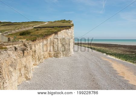 White chalk cliffs and shingle beach at Birling Gap near to Beachy Head at Eastbourne East Sussex England.