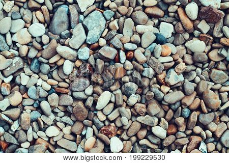 Sea pebbles. Small stones gravel texture background.Pile of pebbles thailand.Color stone in background.
