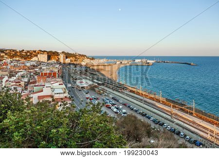 ARENYS DE MAR BARCELONA SPAIN - FEB 20 2016. View over the town the beach and the fishing harbor of Arenys de Mar on the mediterranean coast near Barcelona.
