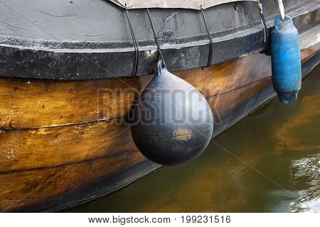 Fenders on a traditional wooden ship in the Netherlands
