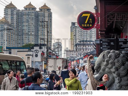 Shanghai, China - Nov 6, 2016: Crowds of people around the 600-year-old Old City God Temple, which is on Fangbang Middle Road.