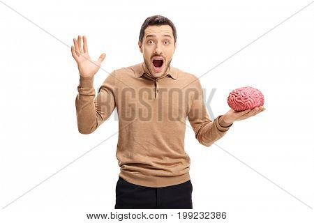 Terrified young man with a brain model isolated on white background