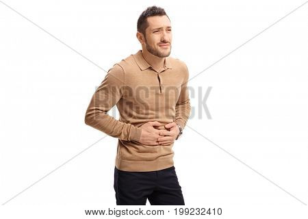 Young man experiencing stomach pain isolated on white background