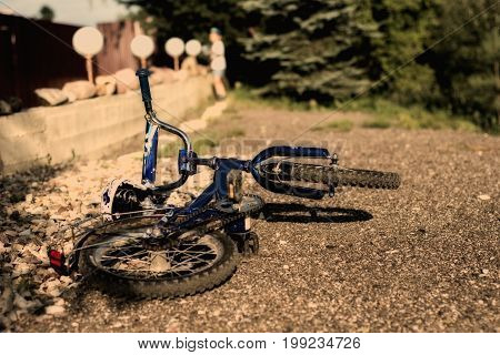 the boy threw his bike on the ground