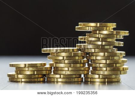 A close up of gold shining twenty euro cent coins