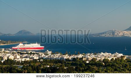 Big red and white ferry boat of the coast Kos island Greece.