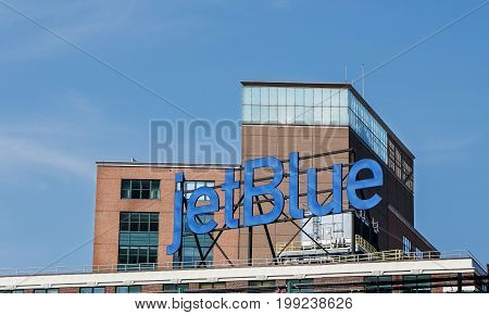 Queens New York August 10 2017: jetBlue advertisement is displayed at the top of a building.