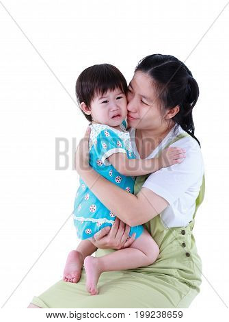 Asian Mother Hugging To Comfort Her Daughter With Love.  Isolated On White.