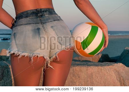 Beautiful Woman In Shorts On The Beach