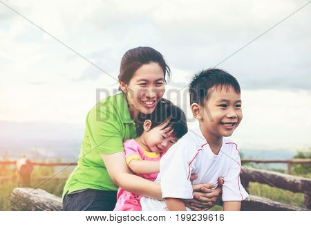 Family With Children Having Fun In Nature Concept. Vintage Tone.