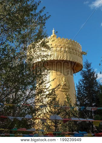 Giant Tibetian Praying Wheel golden architecture in Shangri La Yunnan China