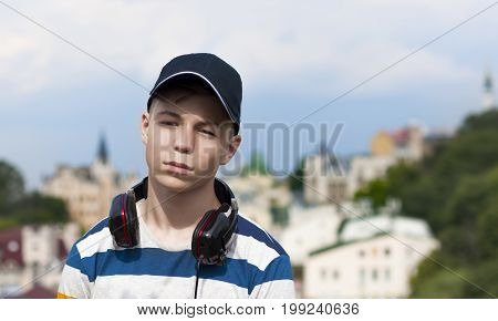 Stylish young man in headphones listening to music