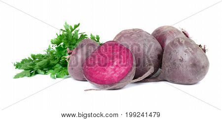 A group of whole red beetroots and green parsley, isolated on a white background. A single beet cut in a half. Young beetroots for healthy smoothie. Organic and natural ingredients. Copy space.