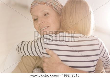 Embracing Mother Suffering From Leukemia