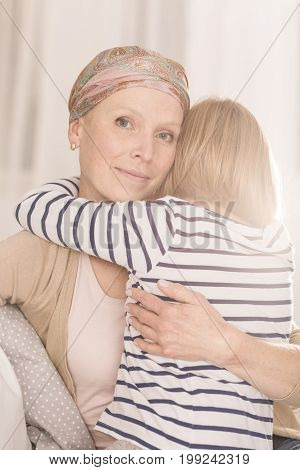 Mother With Leukemia Hugging Child