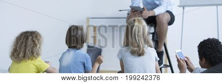 Kids With Tablets And Smartphones