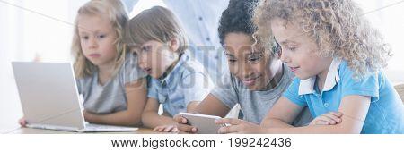 Children Using Laptop And Smarthopne