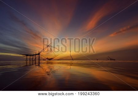 Twilight beautiful sky at fishing village Thailandtraditional local fisherman used net fishing in Pakpra Thale Noi Phatthalung South of THAILAND.