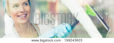 Woman Wiping Window With Squeege
