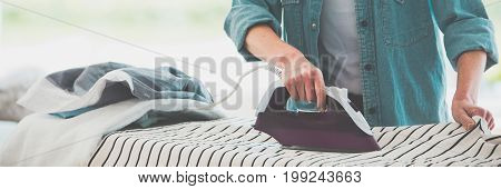 Woman Ironing Clothes