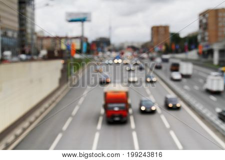 Defocused cars in city traffic as background