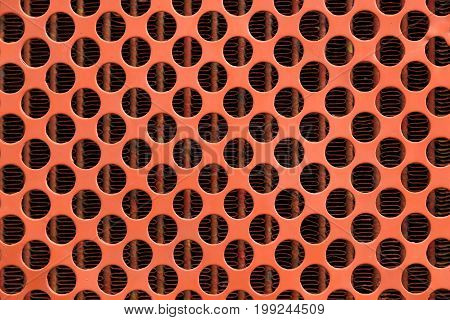 Pattern of orange a steel grating background.