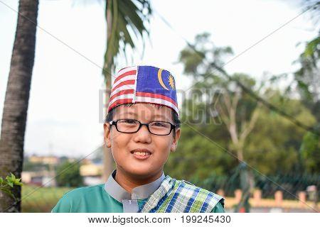 Kuala Lumpur Malaysia- AUG 3 2017: Malaysian primary students with Malaysian Flag during the celebration of Hari Kemerdekaan the Independence Day of Malaysia.
