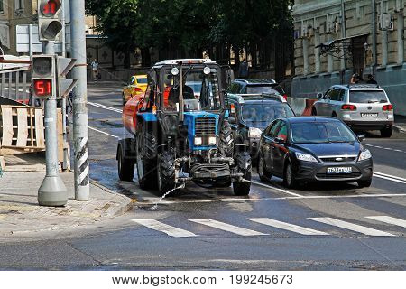 Moscow Russia - July 07 2015: Cars and tractor with the tank waiting for the signal at traffic lights