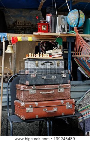 Moscow Russia - September 05 2015: Still life of vintage suitcases chess books at the festival