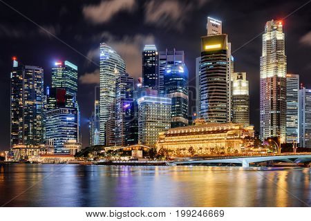 Night View Of Skyscrapers And Old Colonial Building Of Singapore