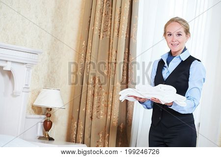 Hotel female housekeeping worker charmbermaid with linen