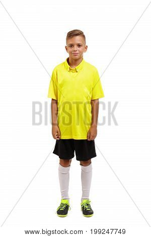 Full height of a young sportsman in shorts, yellow t-shirt, black sneakers and gaiters, isolated on a white background, concept, sport, competition, football, championship, rivalry, match, meeting
