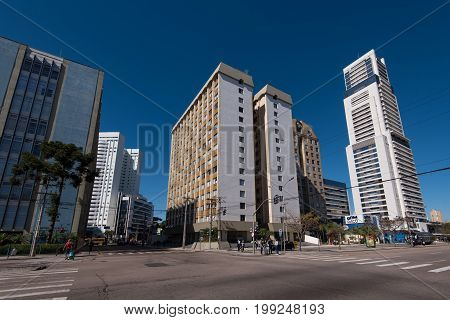 Curitiba, Brazil - July 21, 2017: Streets and buildings of Curitiba city downtown on a beautiful sunny day.