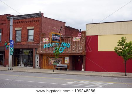 CADILLAC, MICHIGAN / UNITED STATES - MAY 31, 2017:  One may drink beer at the Roaring 20's Saloon in Downtown Cadillac.
