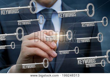 Businessman Writes Key Words .