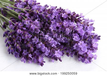 Bouquet of lavender on a white wooden background.