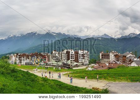 Estosadok Sochi Russia - June 10.2017: Tourists take pictures of sights of the ski resort