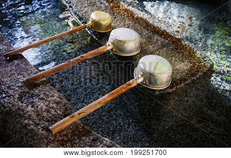Water dipper at japanese shrine Tokyo Japan