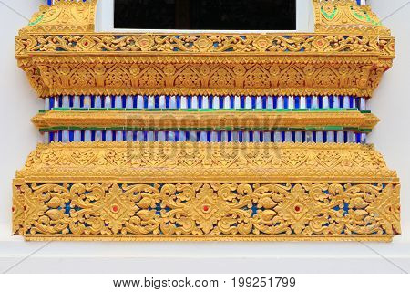 Close up pattern of base of windows Thai Buddhist church in Chiang Mai Thailand.