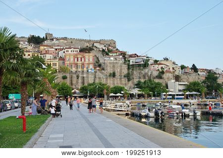 Kavala Greece - June 16 2017: city in the northern Greece in the Macedonia-Thrace region located on the Aegean Sea. View of the harbor and a part of the city. On the hill above the town you can see Byzantine citadel.
