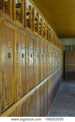 Dachau Concentration Camp Germany - August 29 2015: Wooden lockers from barrack room showing terrible prisoners living conditions from extermination camp.